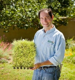 Chief Horticulturalist David Salman with a tray of our Buffalo Grass Plugs