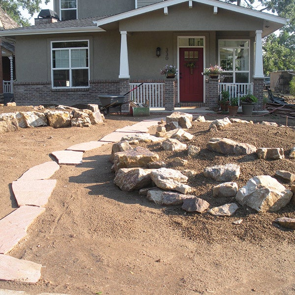 A local landscaper placed a flagstone path between the two garden beds.