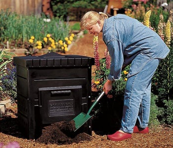 Toss in a shovelful of finished compost or garden soil to help get your compost 'cooking.'