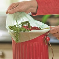 Biodegradable liners that you can toss right into your compost bin make cleanup a breeze.