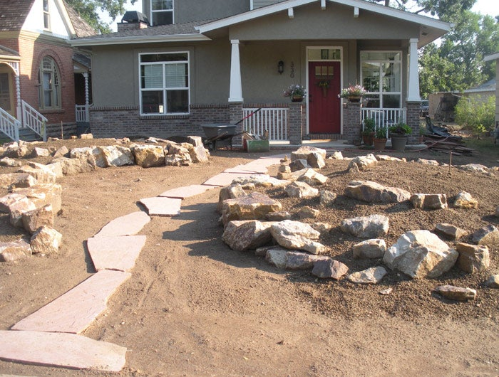 Stones for the rock garden were put in place.